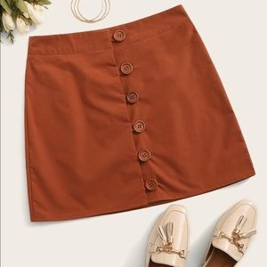 New solid button front skirt